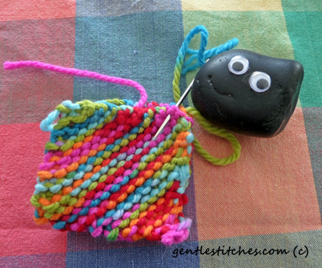 Pet Rock Bashful helping with sewing.